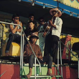 Group of guys on ride: Rotorua Fairground, c. 1973